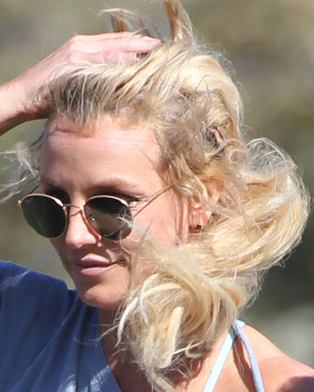 Britney Spears unwittingly shows her messy hair extensions after her hat blows off at her son's football game in Los Angeles, California on February 6, 2016. Pictured: Britney Spears Ref: SPL1222324  060216   Picture by: Lauren / Splash News Splash News and Pictures Los Angeles:	310-821-2666 New York:	212-619-2666 London:	870-934-2666 photodesk@splashnews.com