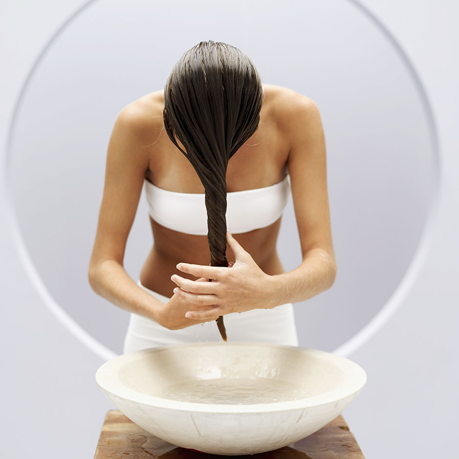 young woman washing her hair